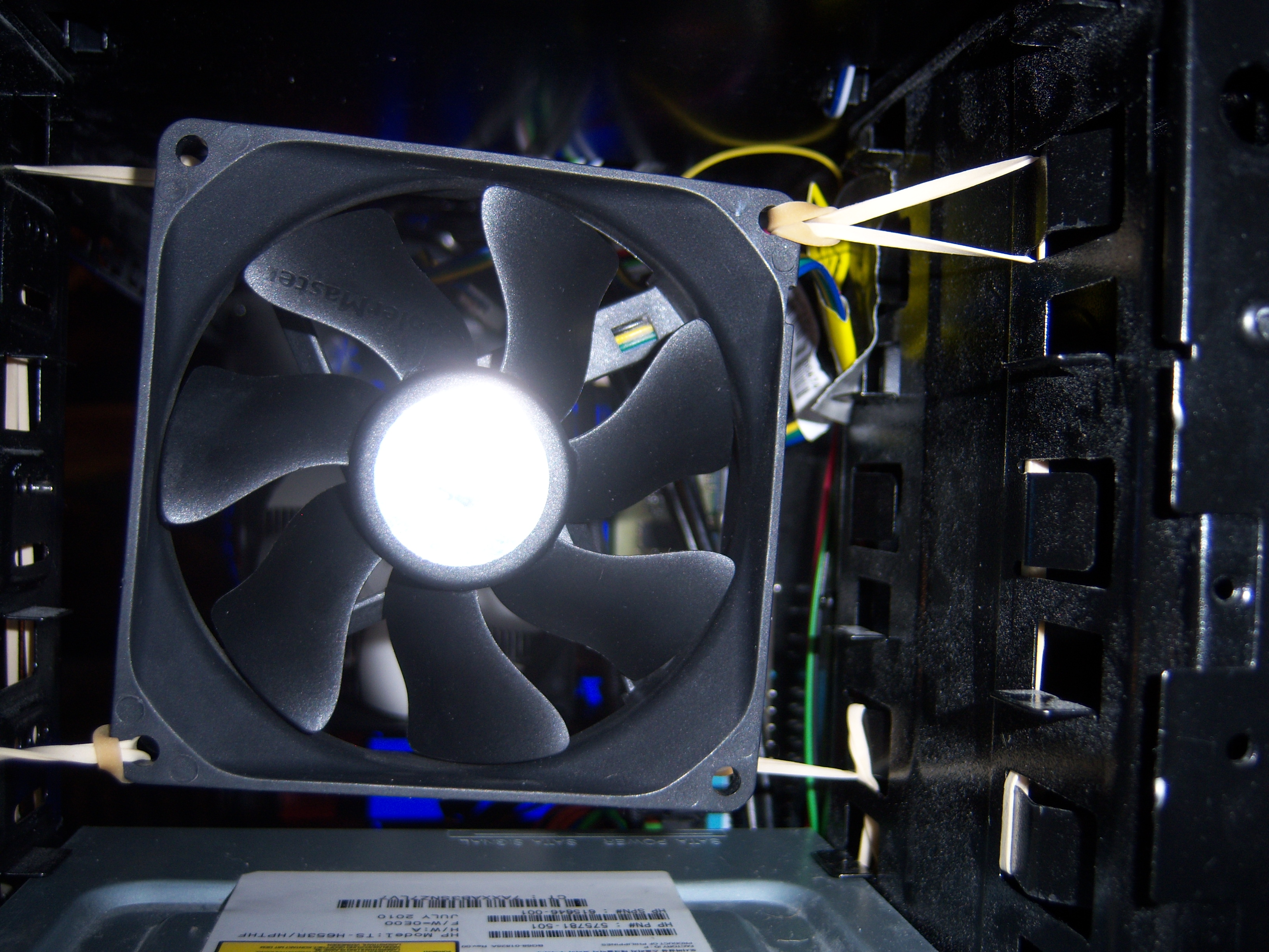 """92mm fan above DVD drive in empty 5.25"""" bays. Used as extra intake to try and push air across the memory"""
