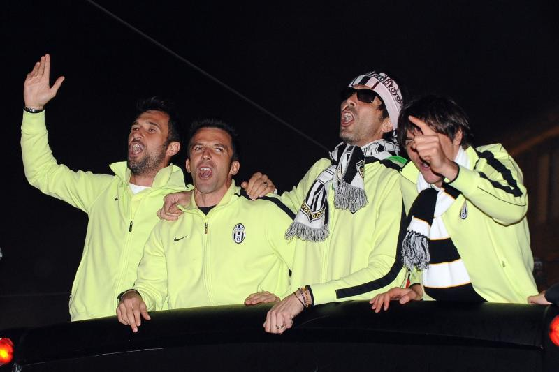 Juventus players celebrating the Serie A championship title.