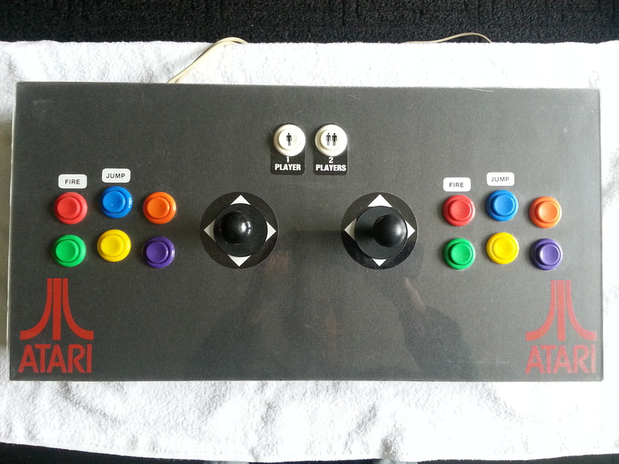 Players 1 & 2 controls. You'll notice here the carriage bolts holding the joysticks are concealed.