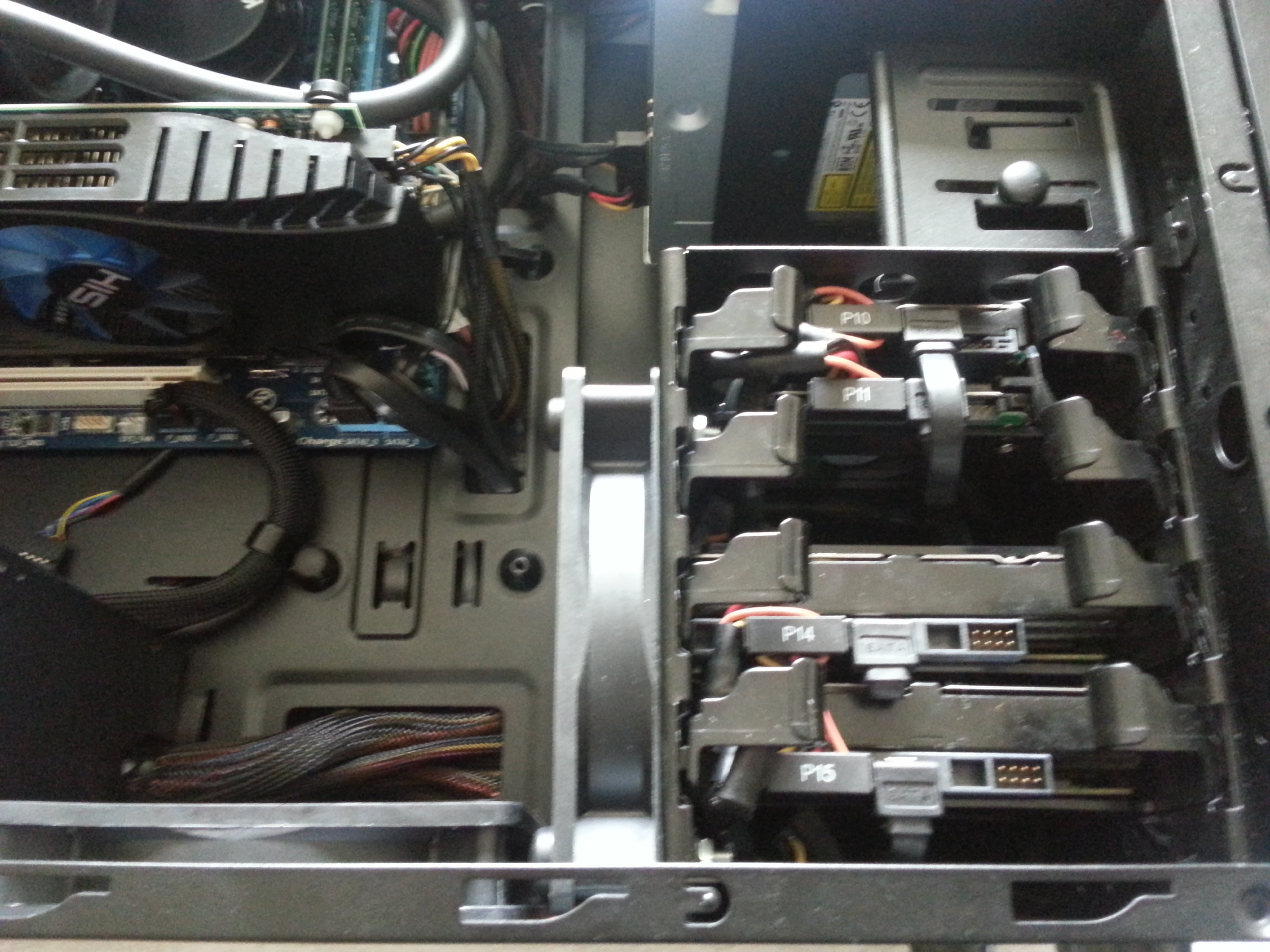 """HDD cage contains 2x 3½"""" 7200 S-ATA II drives (Windows 7 drive, Windows 8 drive) and 1x 2½ S-ATA II (applications, games drive) and 1x S-ATA I 2"""" (media drive)"""