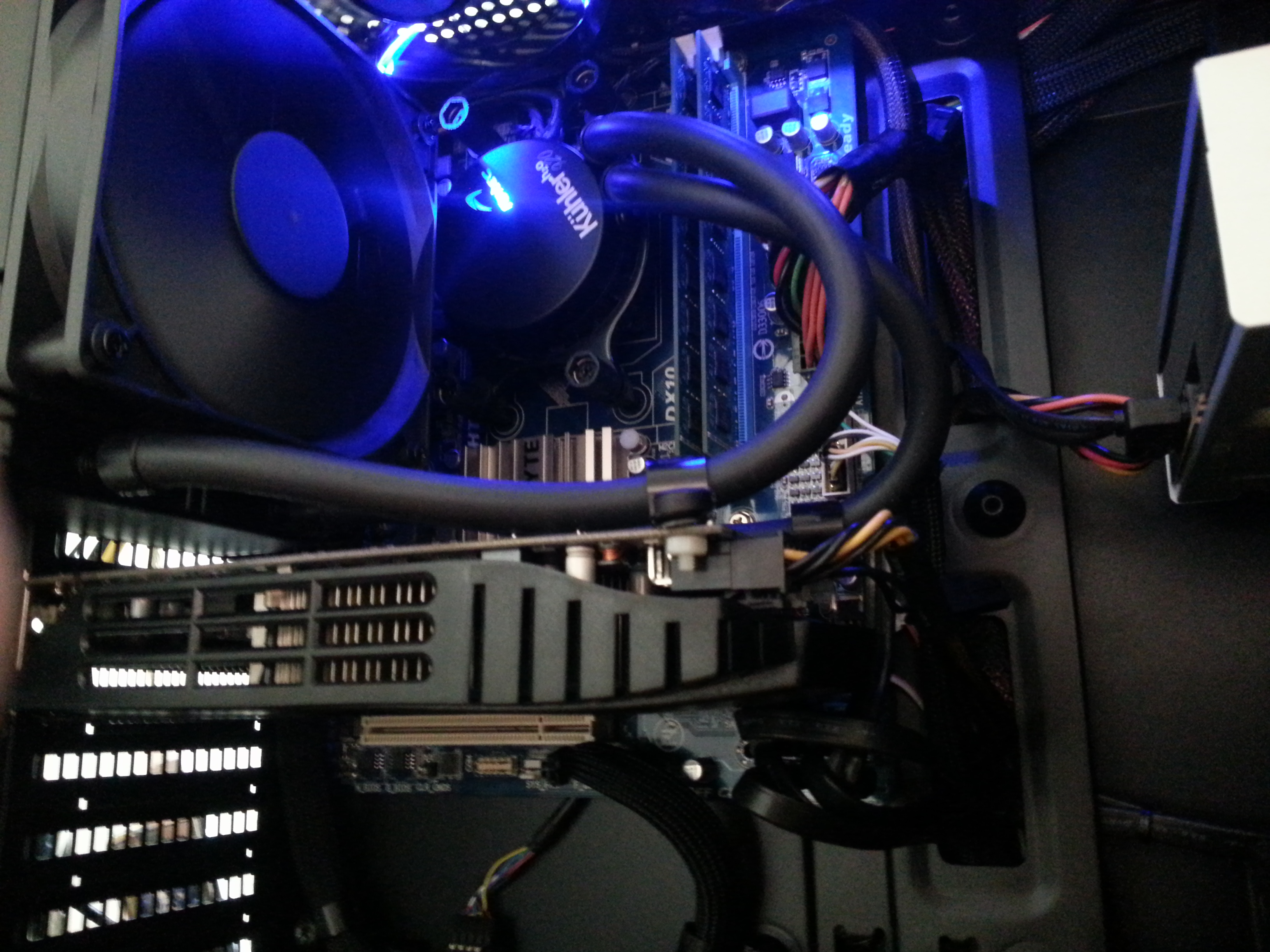 The glowing blue LED's, look sharp in the dark. The GPU actually covers the PCI-e x1 slot and the $39.00 Gigabyte board has two internal headers and two external (8 USB 2.0 ports) Adding PCI card with USB would only give me  USB 2.0 rather than USB 3.0 because of bandwidth architecture of the slot / buss. The next board up was $35.00 more and the ribbon cable and PCI-e USB 3.0 card was only $12.00 so was good deal. There is barely, I mean barely enough room to actually bend the ribbon and duck the GPU to put the covered slot to use. I have yet to install it and when I do I will be sure to post pictures and comments. My current USB usage is extensive. I am using ports for, Microsoft 5000 mouse, Logitech HD C910 , Logitech K800 keyboard, Magicjack, Antec cooler, card reader, Bluetooth.