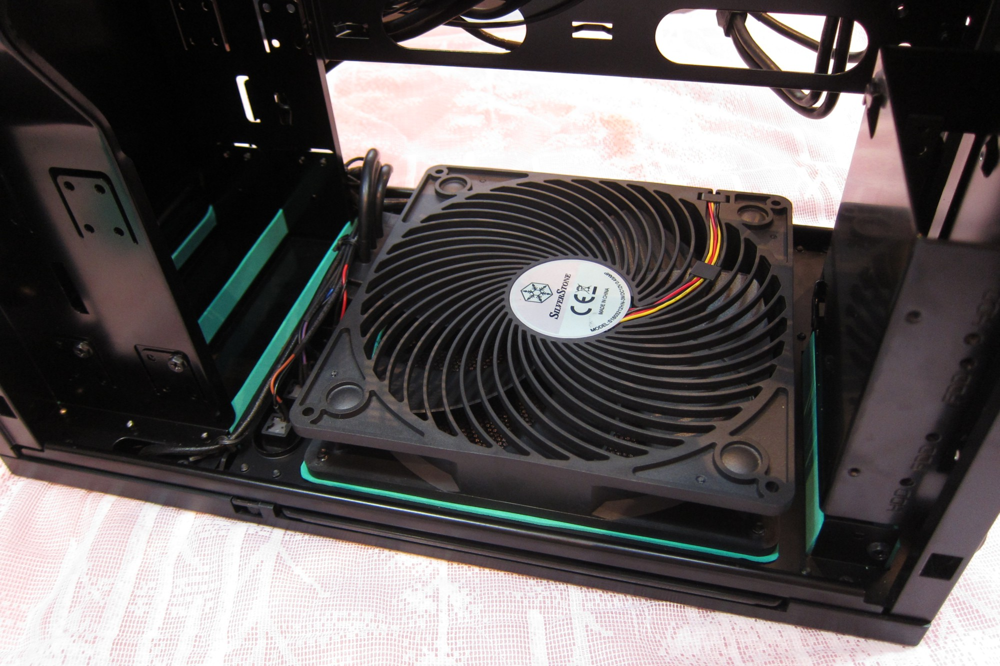 Cut 1.5mm cushion mat for front fan. Then used to block up the large gaps aroung 3.5 bay cover, then decided to continue the theme at 5 inch bay covers also.
