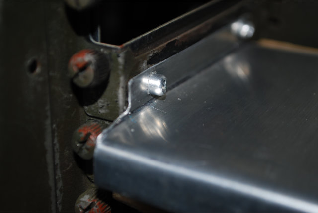 Detached back plate attached to a card expansion bracket.
