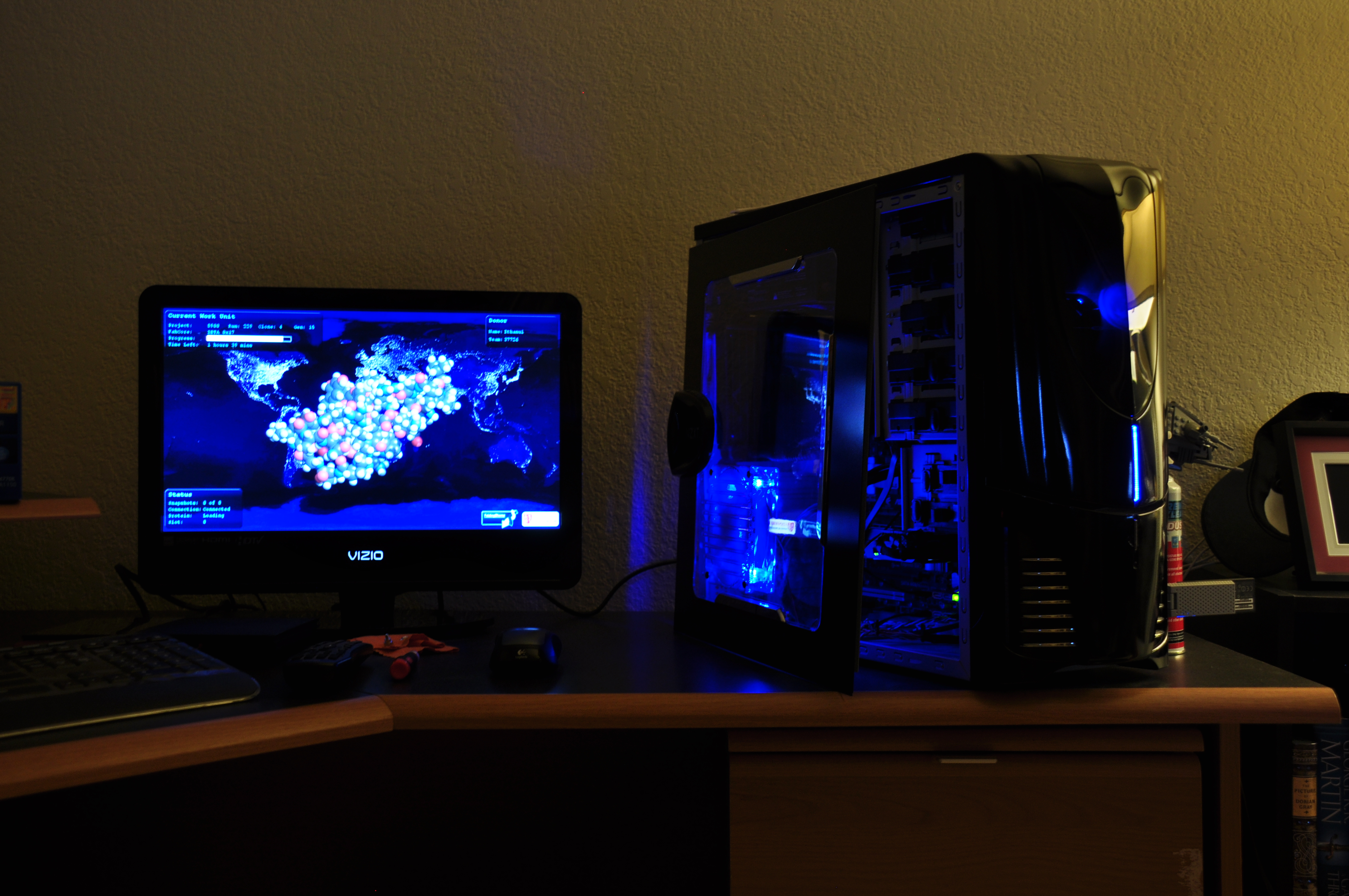 Black Dragon rig chomping away on WUs, open the side since the 590 was getting toasty. Soon to throw the new 7970 into it after 590 gets done with its current WUs.
