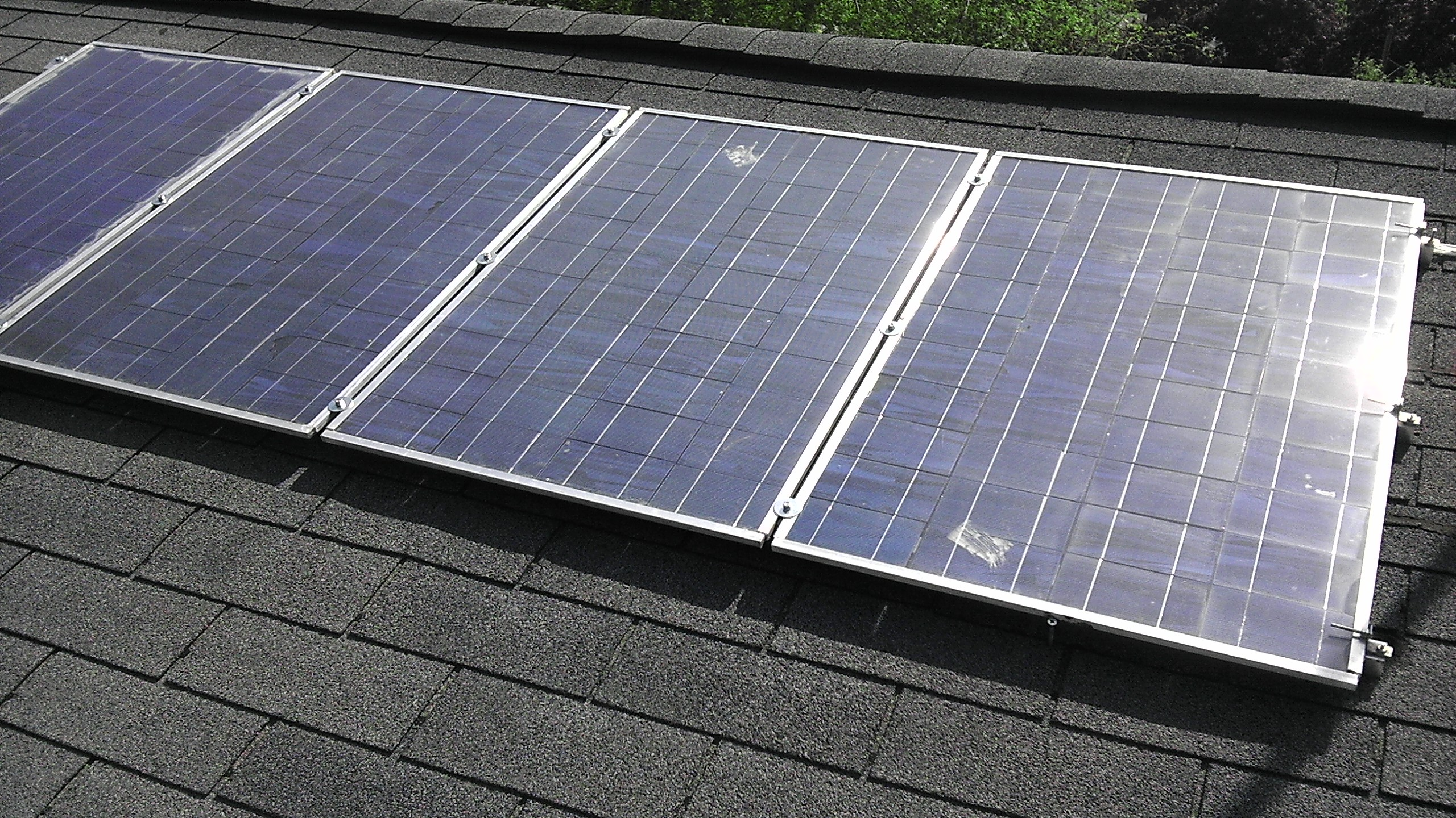 Home made panels(currently 12)  however in summer of 2014 planning to replace with some higher output pro built.  have panels on both sides of my roof due to not having a south facing roof. have a efficiency loss of 9%. compared to pointing them directly at the sun.  summer time output is 630watt, winter about half that.