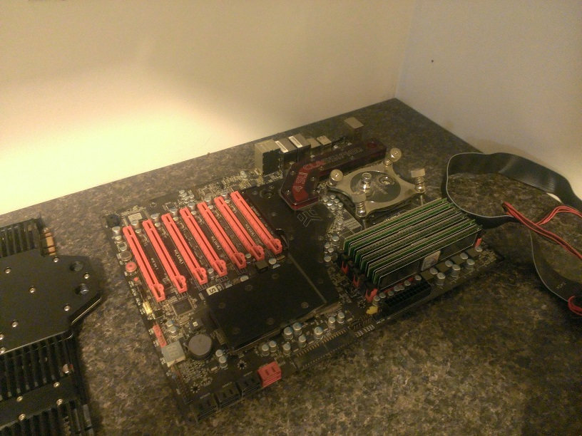 Old EVGA X58 CLassified board with 980X, 12GB OCZ 1600 memory.  EK full board block, and Koolance cpu block