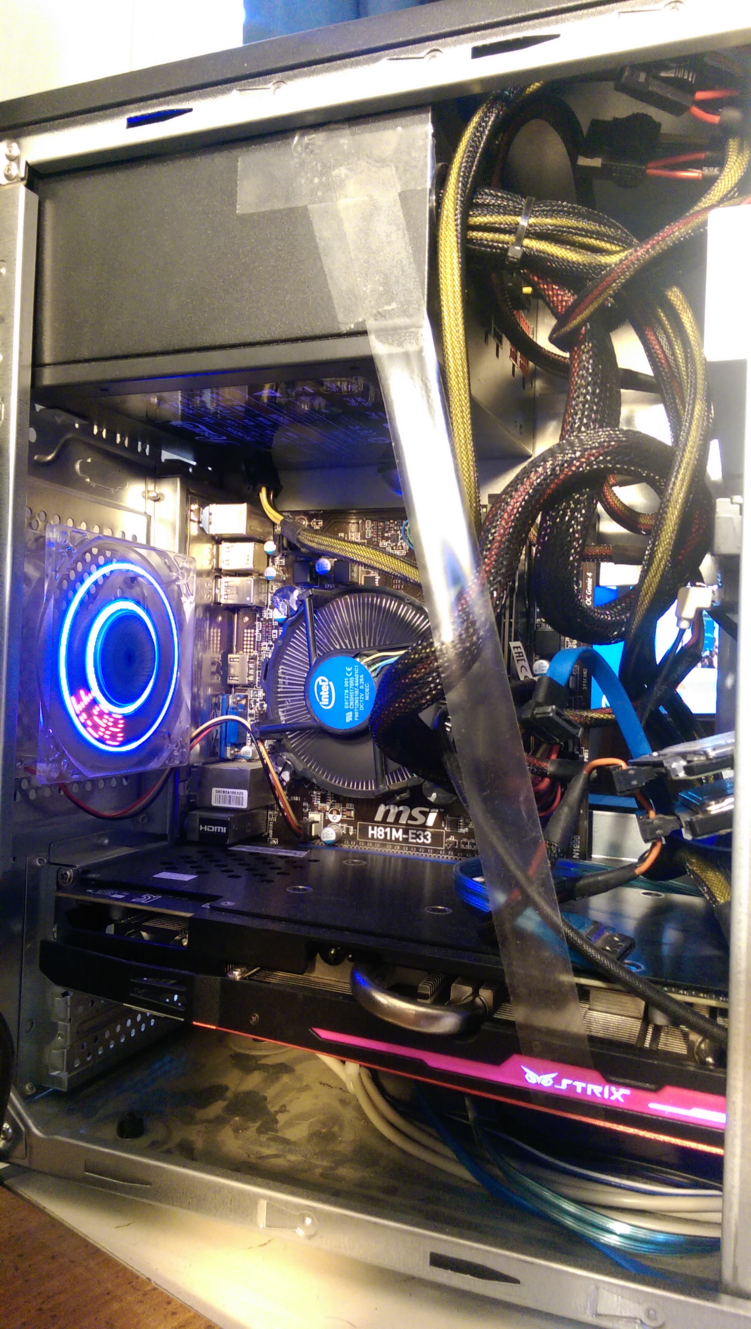 Lol, I know somebody is going to have something to say about the tape, but I'd rather it look n***er rigged than have that 390x hanging with no support and torquing my MoBo. When I finish the build this will be remedied.